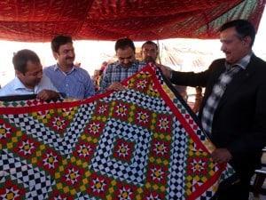 WWF-Pakistan Team Showcasing a Handwoven blanket