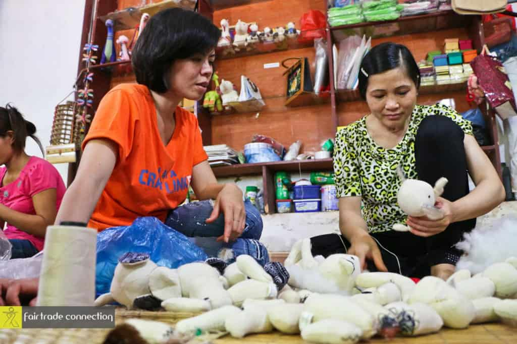 Capacity building is essential- Tien (product designer at Craft Link) giving a training to Huong on how to make stuffed animals Photo credit: Fair Trade Connection